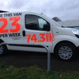 Van side with fluorescent point of sale decals